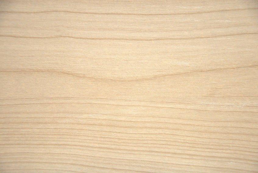 Natural light alder, wood texture on a cut closeup. Background.